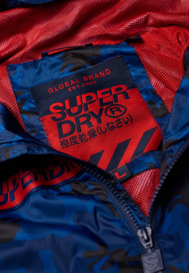 Superdry ANORAK - Veste imperméable - royal blue/ red