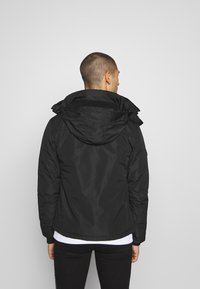 Superdry - ARTIC WINDCHEATER - Chaqueta de entretiempo - black - 2