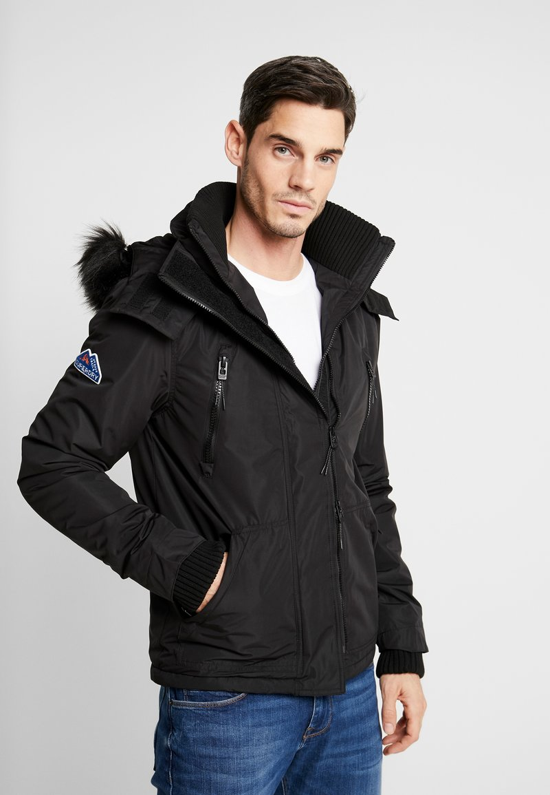 Superdry - HOODED ATTACKER - Light jacket - black