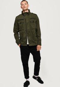 Superdry - ROOKIE FIELD - Outdoor jacket - green - 1