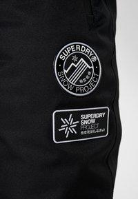 Superdry - Zimní kalhoty - onyx black - 7