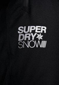 Superdry - Zimní kalhoty - onyx black - 9