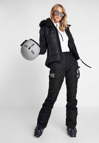 Superdry - Zimní kalhoty - onyx black - 1