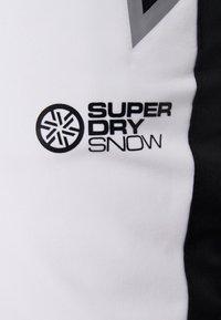 Superdry - SKI CARVE PANT - Täckbyxor - arctic white - 7