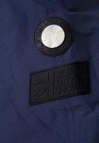 Superdry - SLALOM SLICE SKI PANT - Skibroek - vortex navy space dye - 7