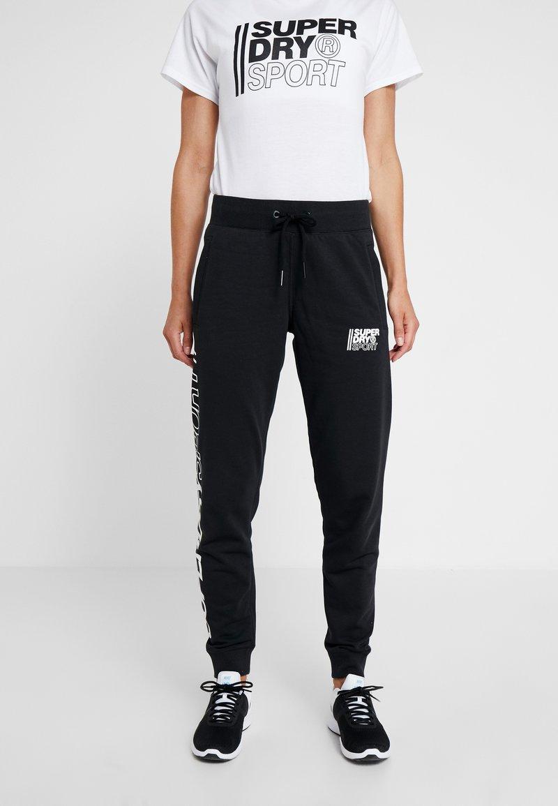 Superdry - CORE SPORT JOGGERS - Pantaloni sportivi - black