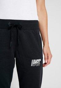 Superdry - CORE SPORT JOGGERS - Pantaloni sportivi - black - 6