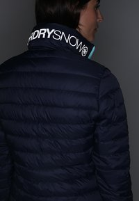 Superdry - Snowboardjas - scratch navy/fluro mint - 8