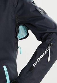 Superdry - Snowboardjas - scratch navy/fluro mint - 5