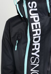 Superdry - Snowboardjas - scratch navy/fluro mint - 4