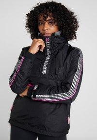 Superdry - SPORT CAGOULE - Trainingsvest - black/flu pink - 0