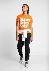 Superdry - HAZARD SPORT TEE - T-shirt print - orange - 1