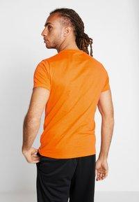 Superdry - HAZARD SPORT TEE - T-shirt print - orange - 2