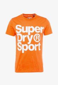 Superdry - HAZARD SPORT TEE - T-shirt print - orange - 4