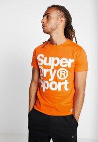 Superdry - HAZARD SPORT TEE - T-shirt print - orange - 0