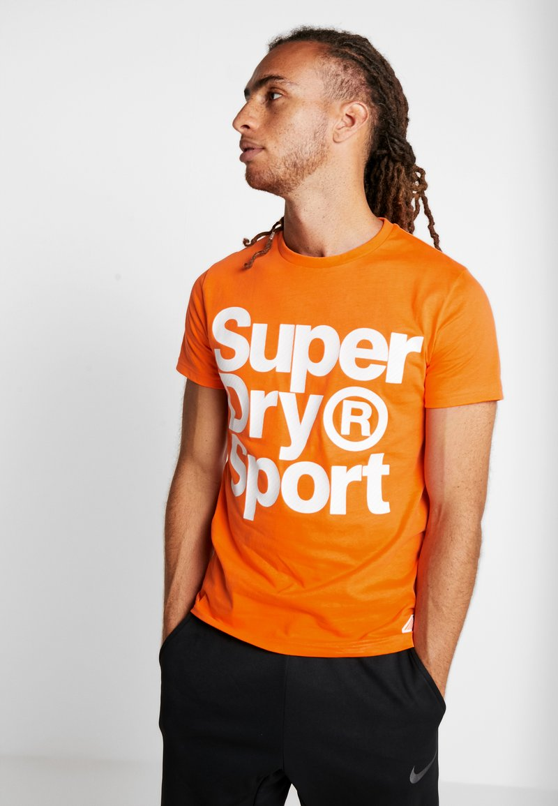 Superdry - HAZARD SPORT TEE - Print T-shirt - orange