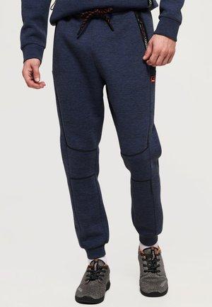 GYM TECH  - Pantalones deportivos - blue