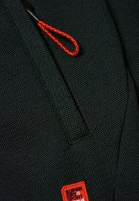 Superdry - GYM TECH - Pantalones deportivos - olivgrün - 2