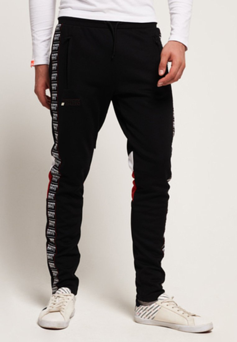 Superdry - Pantalones deportivos - track black/track red