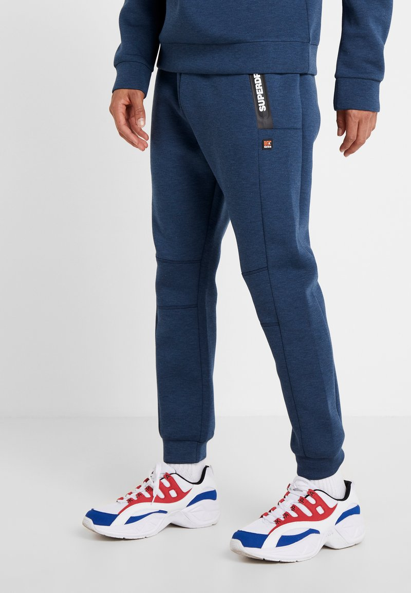 Superdry - CORE GYM TECH - Tracksuit bottoms - deep teal