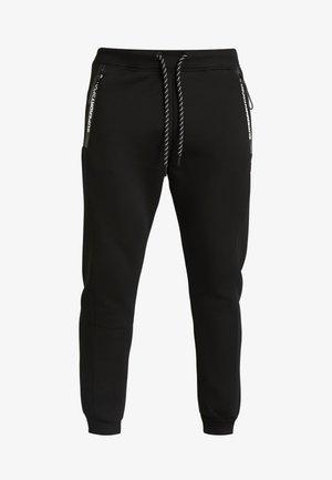 CORE GYM TECH - Pantalones deportivos - black