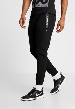CORE GYM TECH - Trainingsbroek - black