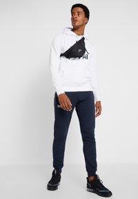 Superdry - CORE SPORT  - Pantalones deportivos - navy - 1