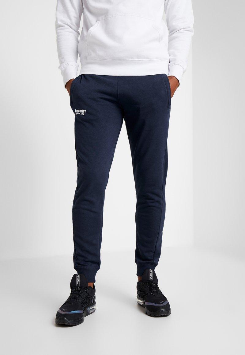 Superdry - CORE SPORT  - Pantalones deportivos - navy