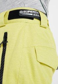 Superdry - ULTIMATE SNOW RESCUE PANT - Pantalon de ski - sulpher yellow - 3