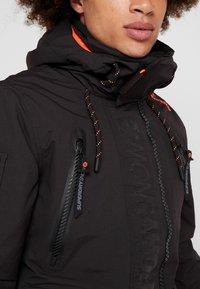 Superdry - ULTIMATE SNOW RESCUE - Snowboardjas - onyx black - 3