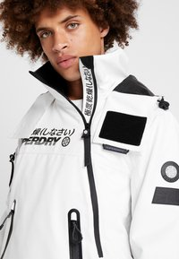 Superdry - SNOW RESCUE OVERHEAD JACKET - Laskettelutakki - arctic white - 5