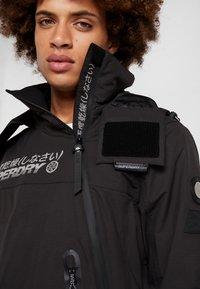 Superdry - SNOW RESCUE OVERHEAD JACKET - Ski jacket - onyx black - 3