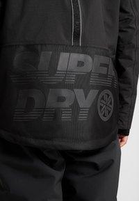 Superdry - SNOW RESCUE OVERHEAD JACKET - Ski jacket - onyx black - 6