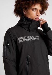 Superdry - SNOW RESCUE OVERHEAD JACKET - Ski jacket - onyx black - 5