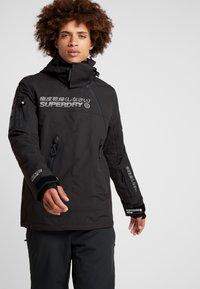 Superdry - SNOW RESCUE OVERHEAD JACKET - Ski jacket - onyx black - 0