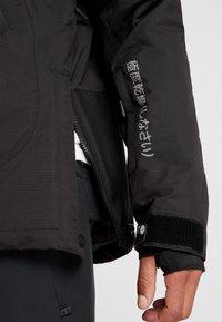 Superdry - SNOW RESCUE OVERHEAD JACKET - Ski jacket - onyx black - 4