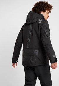 Superdry - SNOW RESCUE OVERHEAD JACKET - Ski jacket - onyx black - 2