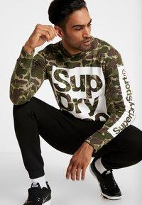 Superdry - COMBAT BOXER CREW - Sweater - dark green - 1