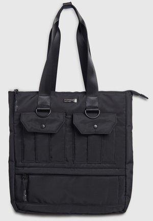 SUPERDRY CONVERTIBLE UTILITY TOTE BAG - Shopping Bag - black
