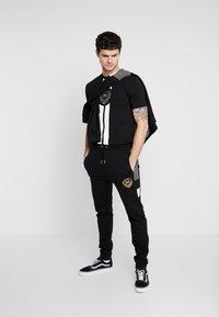 Supply & Demand - FORTUNE  - Teplákové kalhoty - grey/black - 1