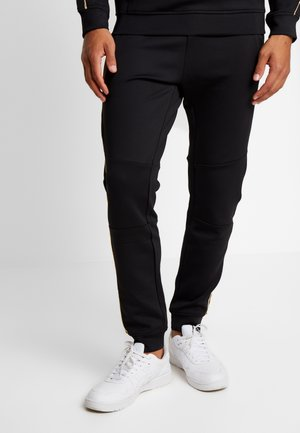 SHINE JOG - Tracksuit bottoms - black