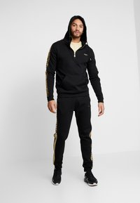 Supply & Demand - SLICK JOG - Tracksuit bottoms - black/gold - 1