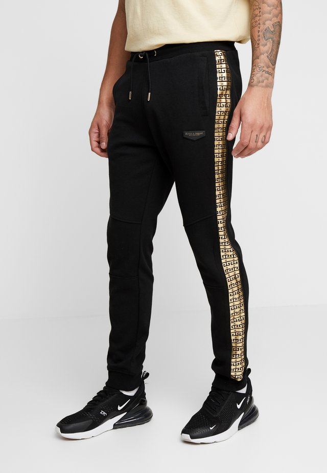 SLICK JOG - Tracksuit bottoms - black/gold