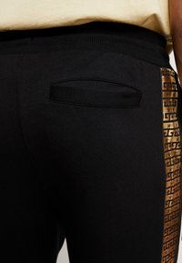 Supply & Demand - SLICK JOG - Tracksuit bottoms - black/gold - 3