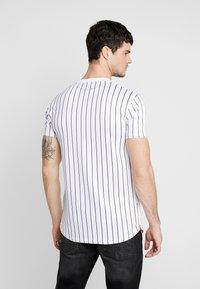 Supply & Demand - QUEST - T-shirts print - white - 2