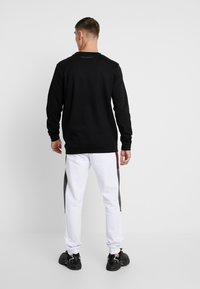 Supply & Demand - FLUSH CREW - Long sleeved top - black - 2