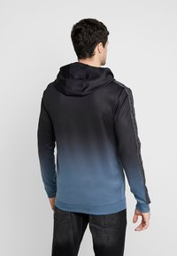Supply & Demand - VANISH HOOD - Trainingsvest - blue/black fade - 2