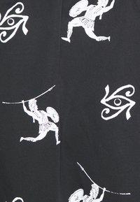 Sweet SKTBS - UNISEX SWEET LOOSE SURFER PANT - Pantalon classique - black - 2