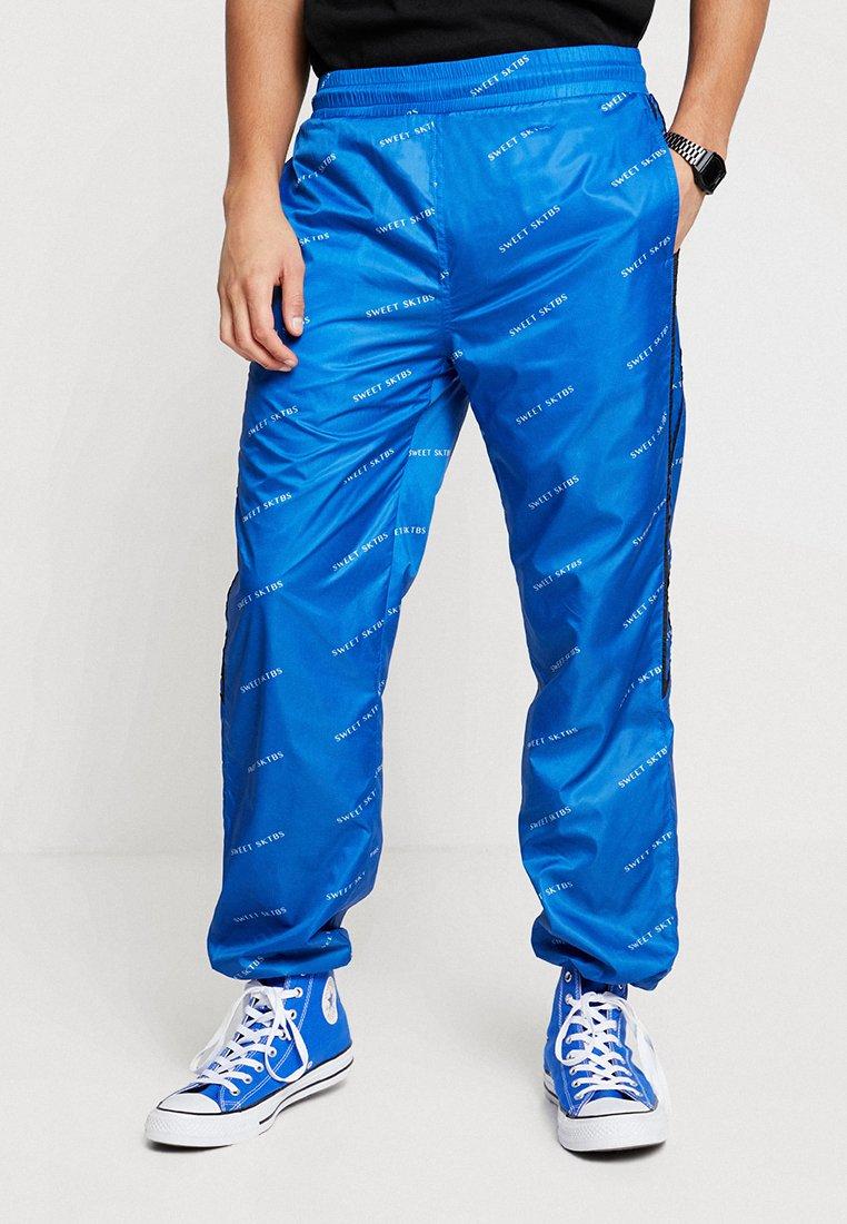 Sweet SKTBS - PANTS SWEET 90'S TRACK - Jogginghose - blue/black