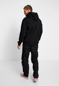 Sweet SKTBS - PANTS  SURFER - Trousers - black - 2